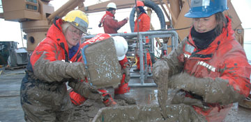Katrin Iken (left) and Bodil Bluhm (right) sifting thorough mud for benthos samples. Photo: Kevin Raskoff, California State University, Monterey Bay